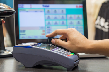cash-payment-and-electronic-cash-register.jpg